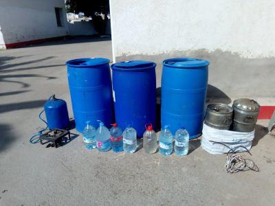 بوسكورة..اعتقال شخص حول مسكنه لمصنع لصناعة ماء الحياة
