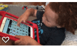 toddler with tablet and AAC application