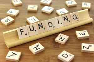 Image of Scrabble tiles, spelling Funding