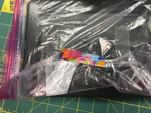 Image of tape on the back of an iPad in a Ziploc bag