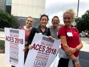 Image of ACES volunteers with signs.