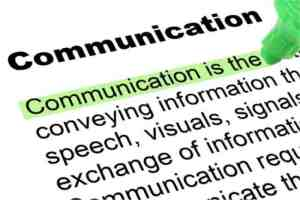 "The word ""communication"" highlighted in a dictionary."