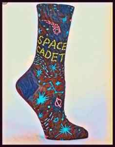 "A sock with stars, comets, and the words ""space cadet"" on it."
