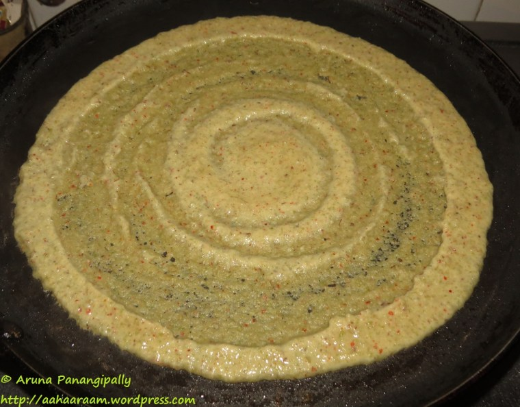 Pesarattu - Spread evenly to form a thickish dosa
