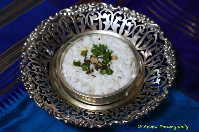 A bowl of sabudana soaked in dahi and seasoned with roasted peanut powder, green chillies and cumin