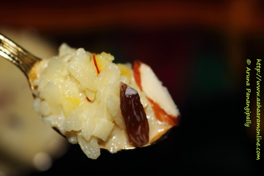 A spoonful of Doodh Poha with dry fruit garnish