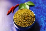 Karivepaku Podi | Andhra Curry Leaves Powder in a bowl on a blue background