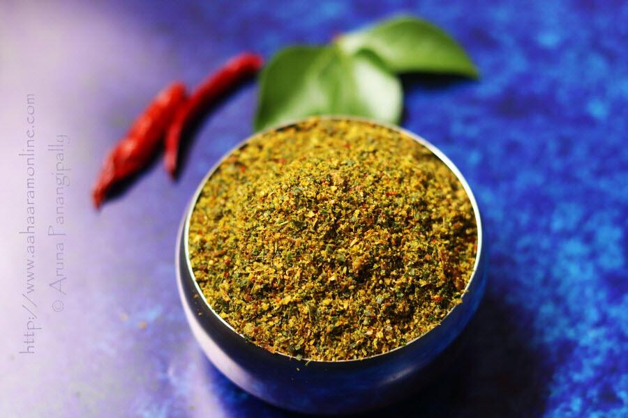 Karivepaku Podi   Andhra Curry Leaves Powder in a bowl on a blue background