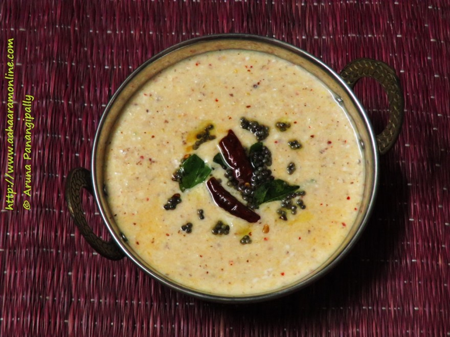Hasi Sasive is a yogurt flavoured with ground mangalore cucumber, mustard, coconut, and red chillies. This is a recipe from the Udupi-Mangalore region of Karnataka.