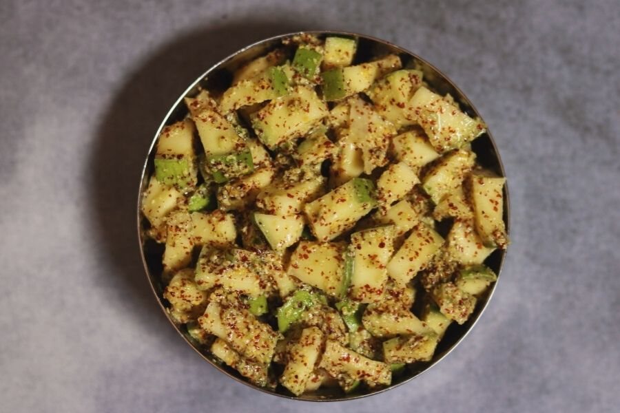 Ava Baddalu: An Instant Mango Pickle made with raw mango pieces and a paste of mustard seeds, green chillies and sesame oil.