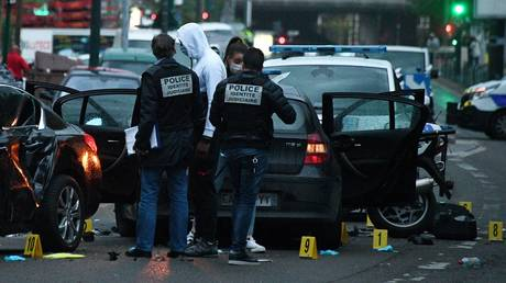 French police officers check the site where a driver injured two policemen in Colombes. © AFP / Franck Fife