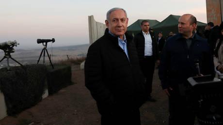 Israeli PM Benjamin Netanyahu and his Defense Minister Naftali Bennett visit an Israeli army base in the Israeli-occupied Golan Heights, November 24, 2019. Atef Safadi / Pool