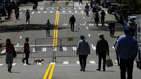FILE PHOTO: People walk along a street in New York, US, on MAy 2, 2020.