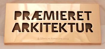 Aalborg_broncestoeberi_stoebning_bronzestoebning_praemieret_arkitektur_skilte_stoebte_bronzeskilte