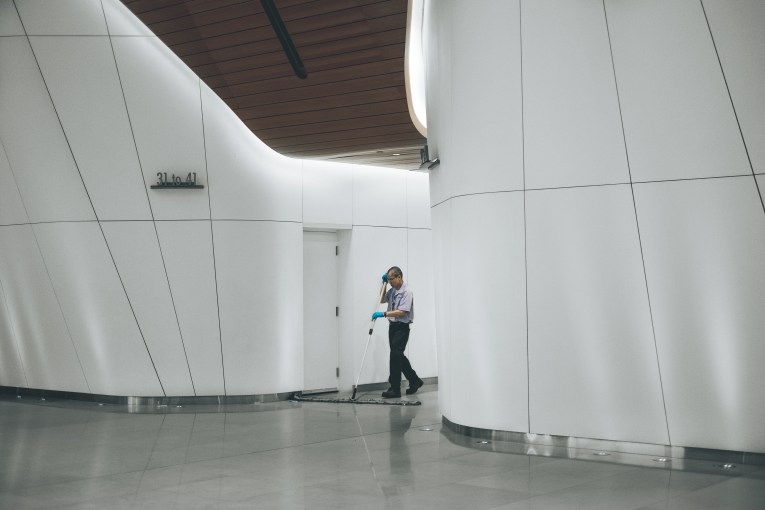Man sweeping office hall