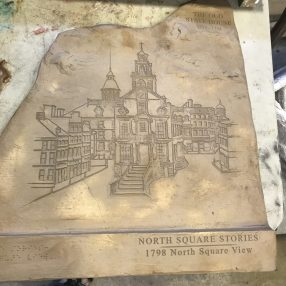 One of the cast bronze panels for 1798 North Square View