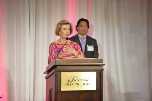 Linda Cadwell accepts Asian Hall of Fame honor for the late Bruce Lee, with actor Jason Scott Lee.