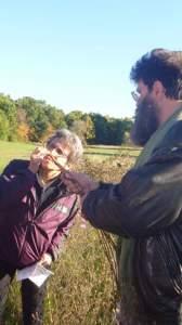 Idelle and Drake examining a plant at the 2014 Sukkot Retreat