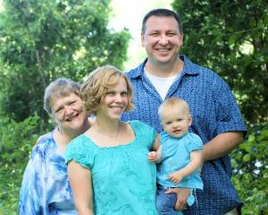 Sally George, far left, with her daughter, son-in-law, and granddaughter.