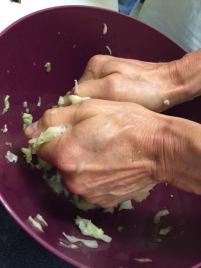 Massaging the salt into the cabbage