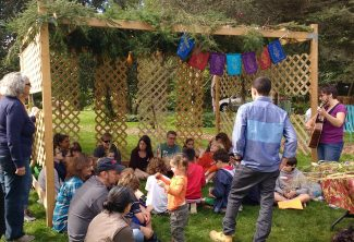 Enjoying dwelling in the sukkah.
