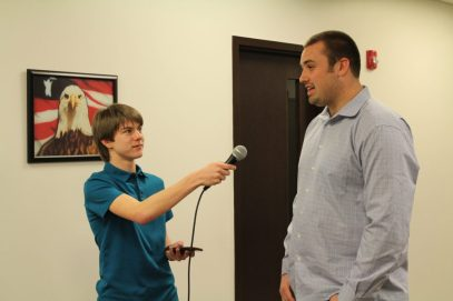 Aaron Hanania interviewing Super Bowl champion Michael Schofield