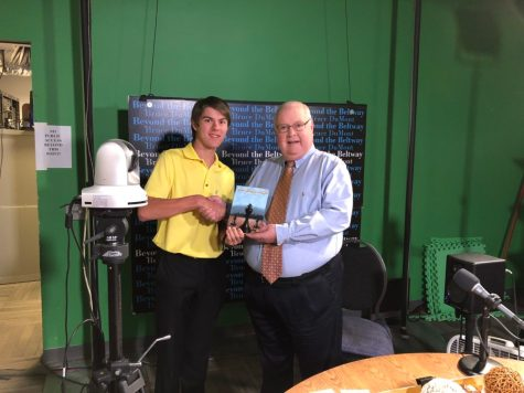 """Radio host and Museum of Broadcast Journalism director Bruce DuMont with a copy of my new book, """"The King's Pawn"""" at his radio studio"""
