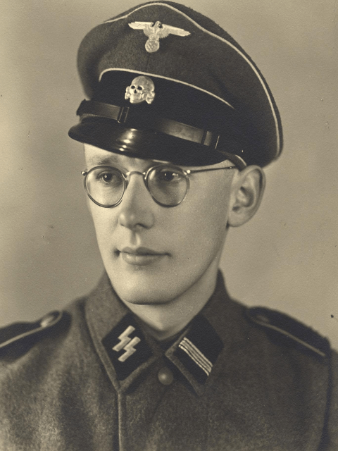 Black and white Oskar Groening portrait photograph .He was a young man with spectacles, and wearing the SS uniform.