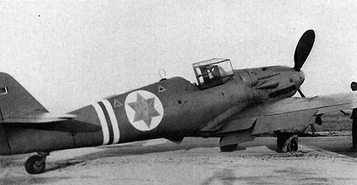 Black and white photograph of Israeli Air Force Avia S-199 Messerschnitt with an open hatch and star insignia. Nazi Weapons of Mass Destruction.