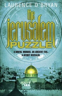 Colored image of book cover for 'the jerusalem PUZZLE' by Laurence O'Bryan. Pale Blue background. with the title in gold script inside a large circle. Illustration of Jerusalem with the gold Dome of the Rock. Middle East political thrillers.