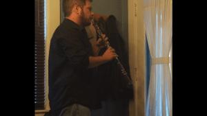 Aaron holding oboe