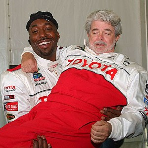 2ace1-john-salley-holding-george-lucas