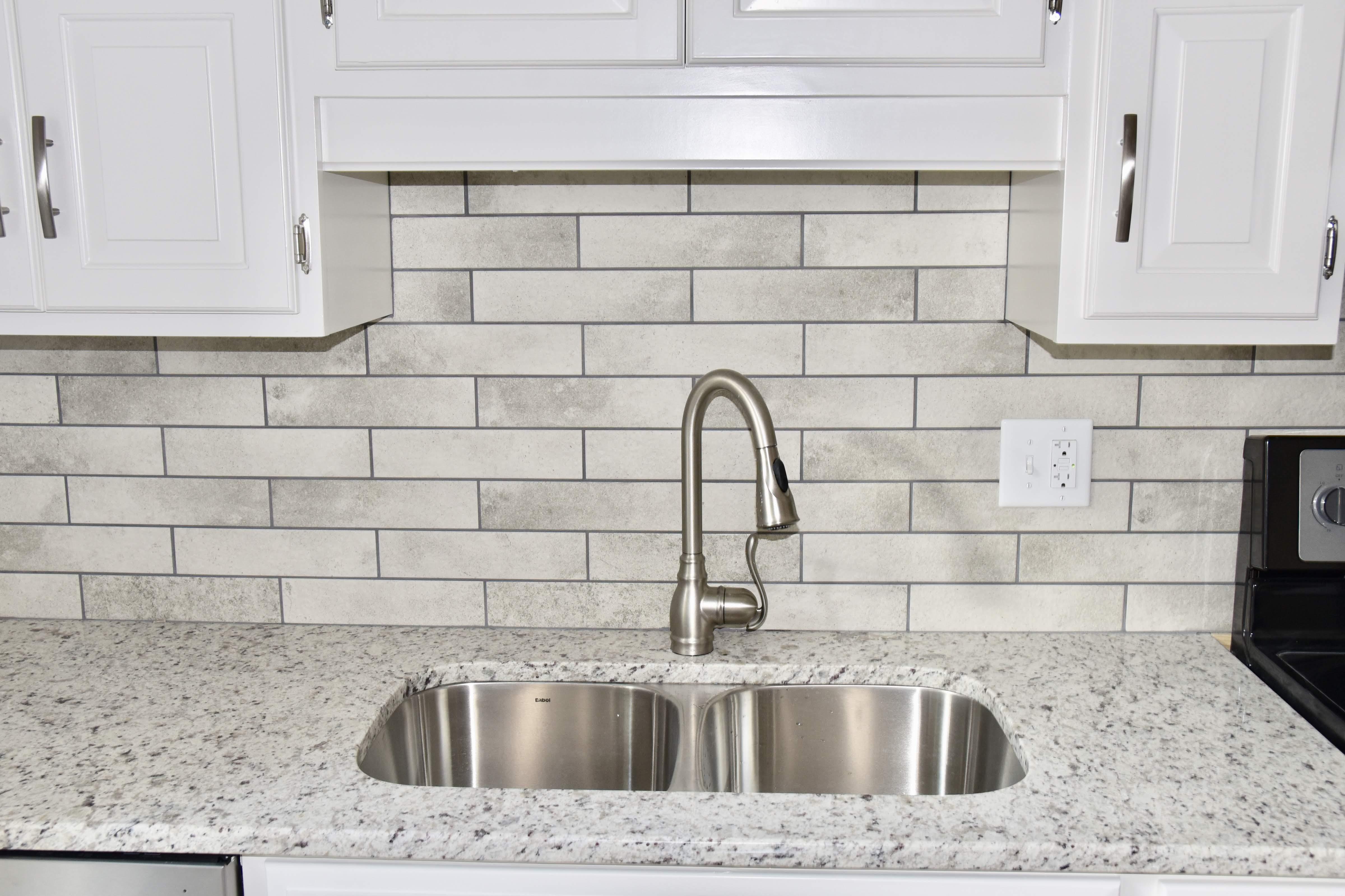 Kitchen Remodel Tile Backsplash. Newly installed granite ... on Granite Stove Backsplash  id=40846
