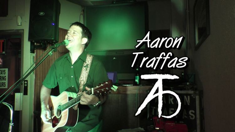 Aaron Traffas plays live country music in Kiowa Kansas