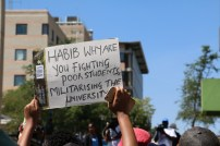 Students at Wits University hold up placcards during FeesMustFall protests