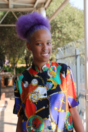 Noxolo Sikane is all round colourful and spring ready in her print blouse and bright and beautiful purple hair. Photo: Aarti Bhana