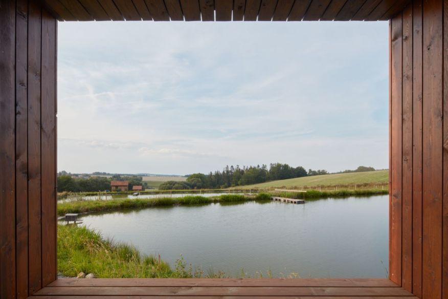 Cottage Near a Pond