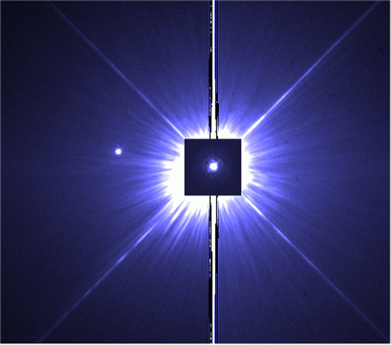 "In this false-color, near-UV Hubble image, a 0.14-s exposure of Procyon A is superposed on a 100-s exposure of Procyon B (in which Procyon A is saturated). The subgiant and white dwarf orbit each other with a maximum angular separation of less than 5"", creating a distinct challenge for astronomers to observe. [Bond et al. 2015]"