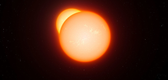 Artist's impression of an eclipsing binary system, wherein one star passes in front of the other as it orbits. These systems are one of the few cases where we can directly measure stars' masses and sizes. [European Southern Observatory]