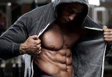 Guy Showing Off Abs and Chest Magazine