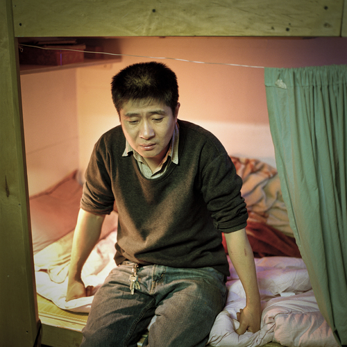 Mr. Chu, an immigrant laborer from China, once lived in cubicle #4 at 81 Bowery. Like many immigrant laborers, he lives on very little and sends most of his earnings back to his wife and children back in China. | Annie Ling