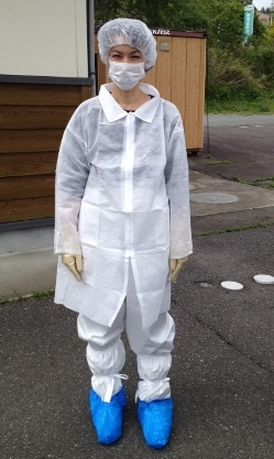 Marie Mockett wearing an anti-contamination suit before entering into the