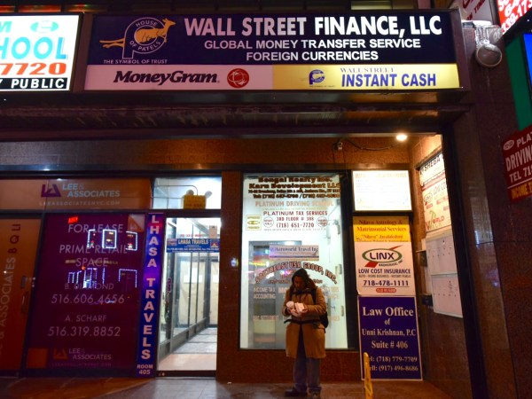 Alternative financial services like these on Broadway in Jackson Heights serve the Nepalese and Tibetan communities in the neighborhood. According to the report, 40 percent of Bangla speakers and 70 percent of Nepali/Tibetan speakers said banks didn't offer services in their language. (Photo by Thomas Kung)