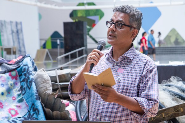 Amitava Kumar reading at the Queens Museum on August 30. Photo by Preston Merchant