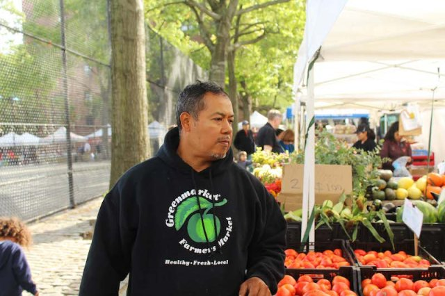 Sergio Nolasco at his stand at the Jackson Heights farmers' market.