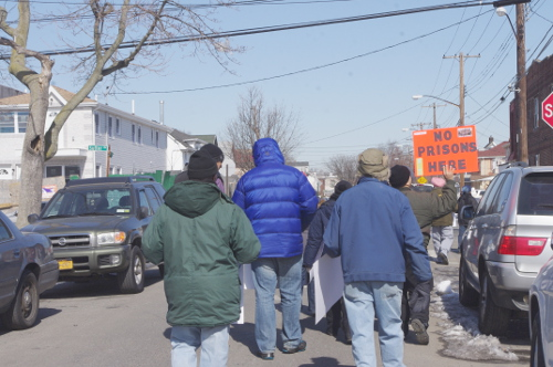 """Demonstrators protest the construction of a """"limited secure"""" facility in South Ozone Park during a march in February. Photo by Nadia Misir"""