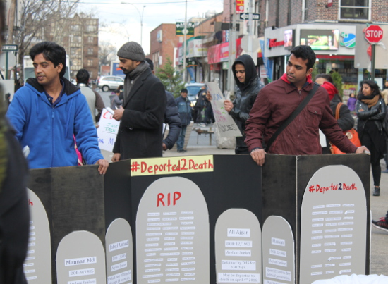 """Protestors hold cardboard gravestones. The headstones were filled with lists of Muslim names and brief synopses of individual migration stories: """"Al Amin; DOB 2/1990; Asylum Seeker; Walked over 3,000 miles through 14 countries."""""""