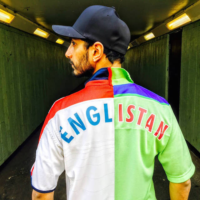Riz Ahmed wearing his Englistan cricket jersey that mixes shirts from the 1992 World Cup-winning Pakistani cricket team and the England cricket shirt.