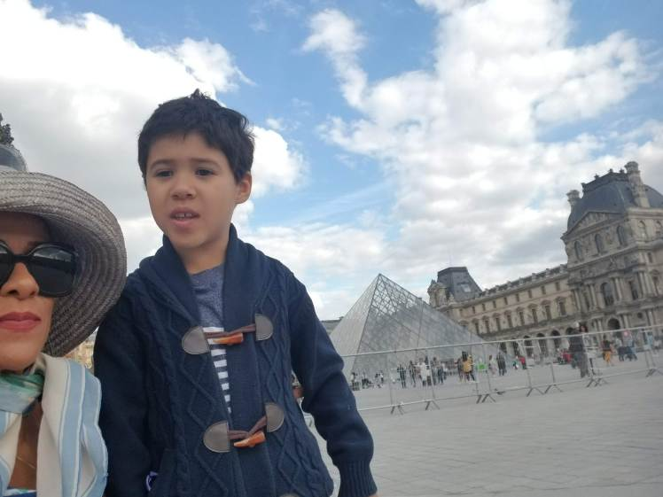 In front of the Louvre Pyramid Paris May 2019