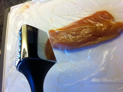 To prevent splashing, layer plastic wrap over the meat. Use the smooth side of the mallet to carefully and lightly pound the meat to a quarter inch of thickness. Work from the center outward (I go in a circle), trying to keep the thickness uniform. Flip once or twice to ensure evenness.
